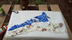 I wanted to dress up an old toilet before turning it into a planter.  I save all broken plates and I did this mosaic of a blue jay.