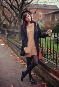 Hat, dress, necklace, jacket, tights, shoes. Brown + black.