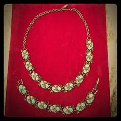 Vintage turquoise speckled set Vintage turquoise choker necklace and bracelet with speckled stones and silver vines.   No chipped stones. Great accent to a strapless dress. Jewelry Necklaces