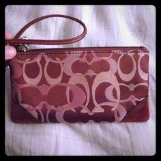 Cute clutch Dark purple clutch with pink and cream colored c's. Someone found this and gave it to me, I do not believe it is actual coach! However it's still super cute and really functional for a night out when you don't want to bring along a whole purse! Coach Bags Clutches & Wristlets