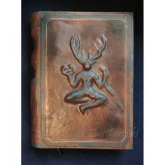 Big grimoire with Cernunn. 200 sheets (400 pages) of paper for sketches, 110g/m2 (edges are slightly burnt), leather cover. You can write with a pencil, any kind of pen, marker (if you write with a marker, it will be slightly seen on the other side of the sheet).