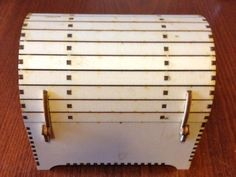 This is a treasure chest with a working lock that I found online, lasercut and assembled for my granddaughter Christmas 2015. Plans are available at http://dxfprojects.com/home/tag/138-treasure-chest-with-lock