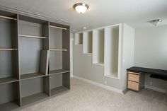 Built in closet solutions, desk and above the stairs storage utilization from our past home. The boys loved to climb in those white ones.  They were the perfect size for stacking the large plastic storage totes.