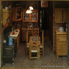 """1:12 and 1:24 Scale Building Displays from the Fall 2012 Seattle Dollhouse Show: Kitchen of 1:24 scale """"Clairevue Cottage"""" exhibited by Joan Claire Bergstrom at the Fall 2012 Seattle Dollhouse Miniature Show."""