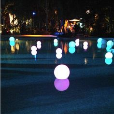 Glow sticks in balloons for pool party lights.