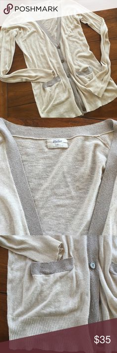 MADEWELL CARDIGAN. SMALL This MADEWELL sweater is the perfect sweater for every season. Lightweight so great for cool spring and summer nights or to take into those places you go to not freeze. Also great in fall and winter. Taupy beige color with a hint of sparkle in the darker contrasting trim down front and neck and on front pockets. In great condition. No holes or stains. Small. Madewell Sweaters Cardigans