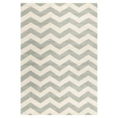 Wool rug with a grey chevron motif. Hand-tufted in India.  Product: RugConstruction Material: WoolCo...