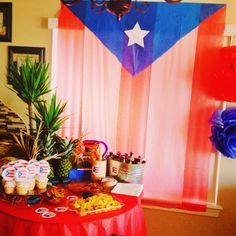 My Table set up for our Puerto Rican party! Made the flag out of plastic table covers from the dollar store, I also made the cupcake toppers  love the turn out!
