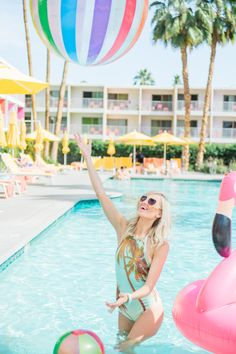 Who is ready for the pool party?! This beb is and she is looking real cute in that swimsuit! Love floaties and beach balls! Looks like a party to us!