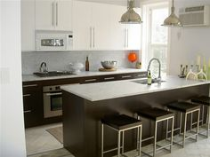 KITCHEN INSPIRATION: White on top but dark brown cabinets below. Still very light and airy...
