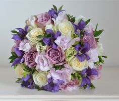 Bouquet of Memory Lane and Dolomiti roses, purple clematis, pink freesias, pale green lisianthus and a touch of myrtle