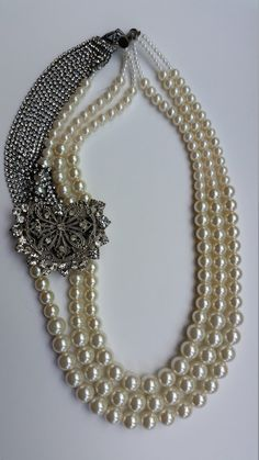 Check out this item in my Etsy shop https://www.etsy.com/ca/listing/237554017/pearl-necklace-with-brooch-three-strand