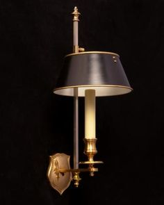 Marvin Alexander,Inc. Gilded bronze one light shield back sconce with painted tole shade.