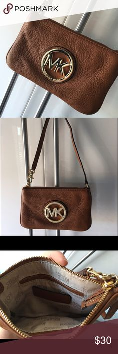 Michael Kors Cognac Wristlet Excellent condition. Like new. Only worn once or twice. No wear on exterior or interior. Bags Clutches & Wristlets