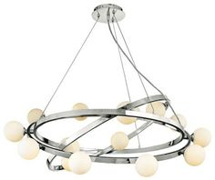 Take any dining table to a whole new level with this cool orbit-style articulating chandelier - a fave from Euro Style Lighting