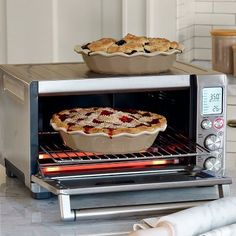 Breville Countertop Convection Oven $250 @Williams-Sonoma. Includes a baking tray, broiling pan, and pizza pan. Nine functions: toast, bagel (??), bake, roast, broil, pizza, cookies, reheat, and warm.