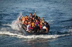 A dinghy carrying refugees arriving at a beach on the island of Lesbos in northern Greece. (Boaz Arad/IsraAid)