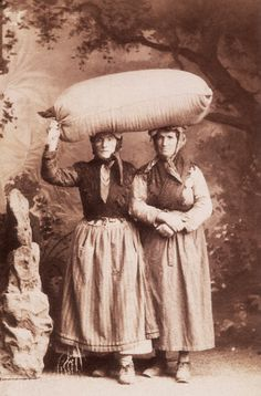 Italian Women With Sack - Italian women pose with a sack of grain atop their heads. San Remo, Italy, ca. 1900.