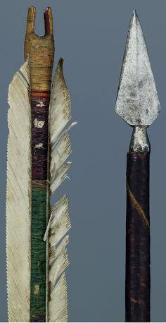 Ottoman arrow, 1550 to 1750,  pine shaft, red, blue and green polychrome paint, with gold flowers and vine decoration. metal filament winding, triple white plumage, forged iron tip, 73.8 cm (length), 25 g (weight).  Museum Hessen Kassel.