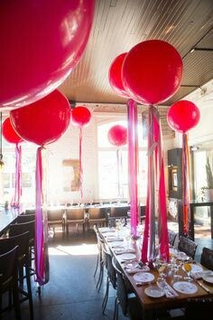 Large balloon centerpieces for heigth with cascading ribbons. Great effect and can minimize flower cost. Keep florals simple at base.