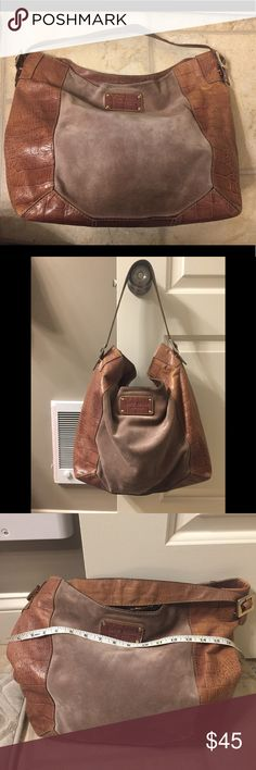 Kate Spade brown hobo Kate Spade brown suede hobo handbag. Overall it's in good condition. I have pics from every angle shown but plz let me know if you have any questions before purchasing. Slight signs of wear on some corners, some jean transfer on the back side of the bag and I'm pointing at it and signs of wear on the buckles. Clean inside. I don't feel the jean transfer is that noticeable since it's dark suede. Great for all seasons! I ship fast! kate spade Bags Hobos