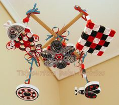 A quilled baby mobile ideal for the baby's visual stimulation. High Contrast Images, Tiny Star, A Hook, Red Pattern, Black White Red, Child Love, Baby Patterns, Gift Tags, Things To Come