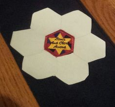 Badges - Here's a helpful tip for sewing on AHG Pioneer and Patriot badges. Make a template like this. The badge will be straight, and you'll be able to sew on future badges without running out of room.