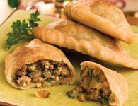 Sirloin Empanadas Recipe Courtesy of Certified Angus Beef LLC To bring international flair to your f�te, here�s an easy way to create empanadas that taste like those from street vendors in Argentina. An authentic flavor combination of beef, cumin and spices meets convenience with store-bought pizza dough.