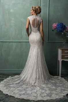 amelia-sposa-wedding-dresses-2014-daria-cap-sleeve-lace-gown-back-illusion-portrait