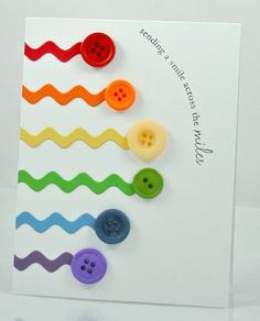 handmade greeting card: Rainbow bright: JUGS #85 from Work in Progress ... clean and simple ... light and bright ... die cut rick rack lines lead to buttons of the same color ,,, arranged in rainbow color order ... buttons form an arch line ... happy card!!