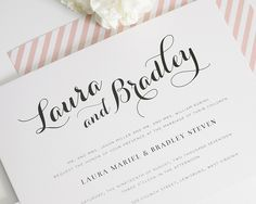 Gorgeous calligraphy wedding invitations in blush pink with a striped envelope liner!