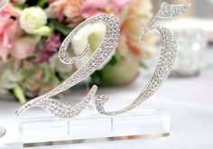 Table numbers (or a cake or guestbook table date display) are especially inviting when twinkling in the candlelight.