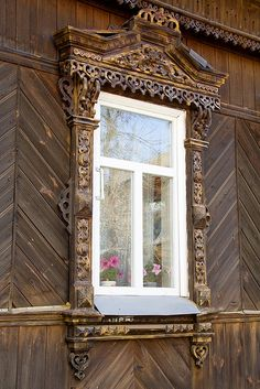 A really spectacular window, in unpainted carved wood, in Suzdal Russia.