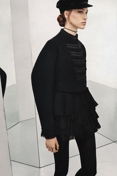 Amanda Googe wears Zara band jacket, contrasting pleated skirt and hat