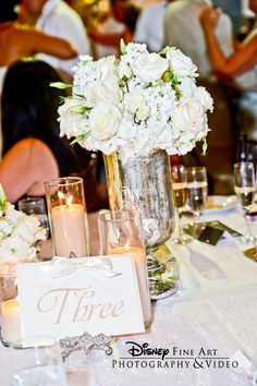 White rose and hydrangea centerpiece in a silver mercury glass vase