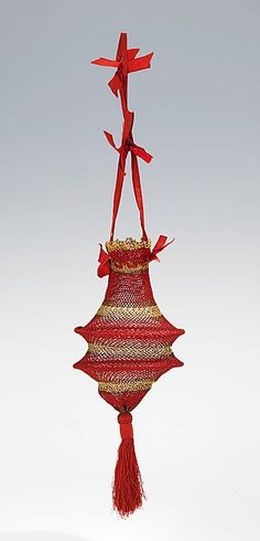 Reticule Date: first quarter 19th century Culture: British Medium: silk, cotton, metal Dimensions: collapsed: 4 1/2 x 6 1/4 in. (11.4 x 15.9 cm) Credit Line: Brooklyn Museum Costume Collection at The Metropolitan Museum of Art, Gift of the Brooklyn Museum, 2009; Designated Purchase Fund, 1982 Accession Number: 2009.300.2197
