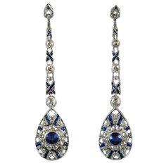 Art Deco Platinum Ear Pendants. A pair of Art Déco platinum, diamond and synthetic sapphires ear pendants. 1925 c.a.
