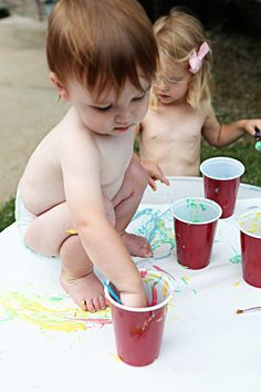 paint for babies- flour, water, food colouring. Don't have to worry about it getting all over them or even them putting it into their mouth