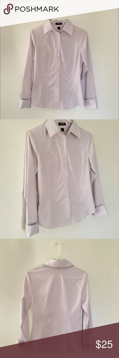 express stretch lilac button down blouse express stretch lilac button down blouse, size 4 • designed to give a sleek & slim fit, this tailored stretch shirt exudes an ultra-modern silhouette to transform your 9-5 or weekend look • pair it with a pencil skirt for the office or a pair of straight leg jeans for a casual weekend - also great for layering with cute sweaters or boyfriend cardigans • in excellent condition! • bundle & save Express Tops Button Down Shirts