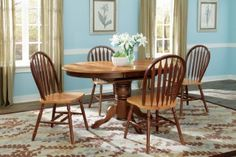"""Round Butterfly Leaf 5 Piece Dining Set in Cinnamon. This sleek round dining table features a classic design with a pedestal base and 18"""" butterfly leaf."""