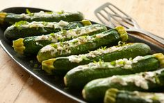 As a tasty alternative, omit the mint and baste the cheese-filled squash with garlic-infused olive oil, using a fresh rosemary sprig as your basting brush. If you're cooking outdoors, try grilling the zucchini instead.