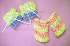 """""""Corset Fingerless Gloves"""" and """"Bubblegum and Lemondrops"""" Fingerless Gloves Show in 0-6 months size. Available in custom color(s) and sizes from preemie to adult! Order yours today! www.facebook.com/TouteBeauteBoutique www.Pinterest.com/TouteBeaute #Crochet #handmade #prop #photo #chevron #girl #corset #ribbon #boy #gloves #fingerless"""
