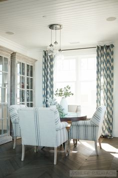 upholstered chairs with a round table, blue accents