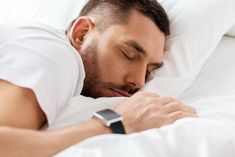 close up of man with smartwatch sleeping in bed by dolgachov. people, bedtime and rest concept ¨C close up of man with smartwatch sleeping in bed Lose Weight At Home, Ways To Lose Weight, Foods That Contain Zinc, Cure For Constipation, Healthy Liver, Healthy Sleep, Technology Photos, Rest, Bedclothes