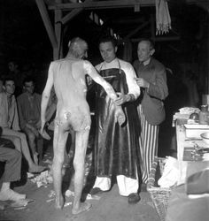 Examining Buchenwald prisoners after the camp's liberation by U.S. troops, April 1945.