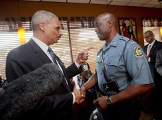 Attorney General Eric Holder talks Wednesday with Capt. Ron Johnson of the Missouri State Highway Patrol, who has been put in charge of security in Ferguson, Missouri. Presidente Obama, Eric Holder, Black Leaders, Killed By Police, Mother Jones, Michael Brown, Beyonce And Jay Z, Department Of Justice