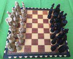 Possibly Studio of Anne Carlton SAC memorabilia// Champion football Themed Chess Set Pieces Beautiful made & great quality. Possibly made of resin or pottery. Approximately the largest piece measures height 15cm, base 3.5cm in diameter, the smallest piece height 10.5cm base 2.8cm in diameter. All Chess pieces are in very good preloved condition. On this sale i will include a beautifully finished vintage chess board, this chess board its little damage one of the corners please se...