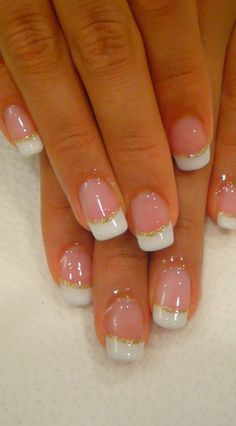 Natural Nails with Gold Glitter French Tips Look at these beautiful natural nails with a gold glitter band around white french tips. This is very pretty and would be perfect for a wedding. It looks…