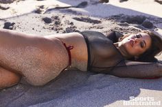 Ashley Graham was photographed by Josie Clough in Nevis. Top by Honey Punch. Swimsuit by Ola Vida.