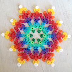 Discover thousands of images about Rainbow snowflake perler beads by jushou Melty Bead Patterns, Pearler Bead Patterns, Perler Patterns, Beading Patterns, Beading Tutorials, Quilt Patterns, Hama Beads Design, Diy Perler Beads, Perler Bead Art